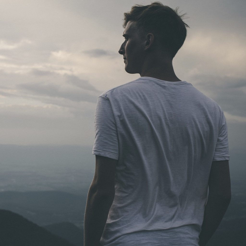man on top of mountain that has accomplished his goals in counseling