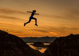 Person taking the plunge and leaping into a major life transition.
