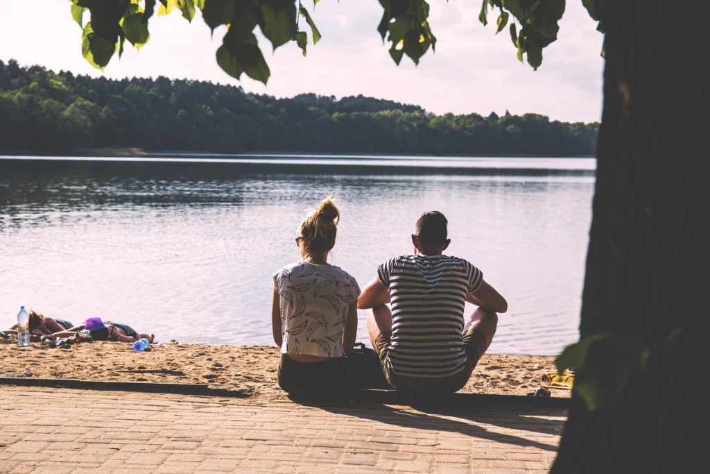 couple contemplating couples counseling while overlooking the water